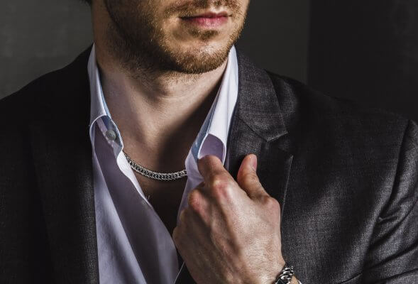 Platinum necklace chain for man in 10mm width with male model from ByEnzo jewelry